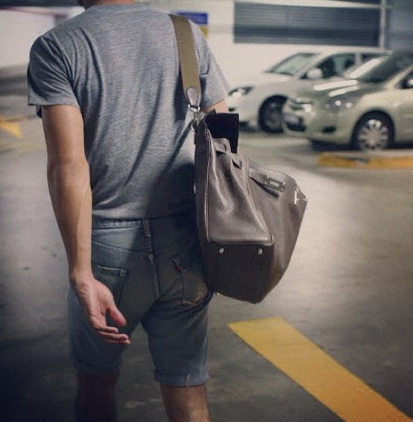 how an hermes kelly bag should be carried by a man.