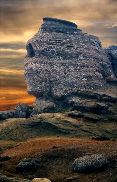 The Sphinx from Bucegi Mountains in Romania. It is located at an altitude of 2,216 metres (7,270 ft). The image of the sphinx appeared when the rock, having an 8 m height and a 12 m width, was watched from a certain angle. The megalith has its clearest outline on 21 November, at the time the sun goes down.romaniasfrie...