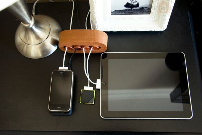 I admit it. I'm a little Apple crazy with all of my hook ups, plug ins, and istuffs. I'm always trying to organize cords and here is a great solution for just that.   Affordable. Simple. Chic. Reused.