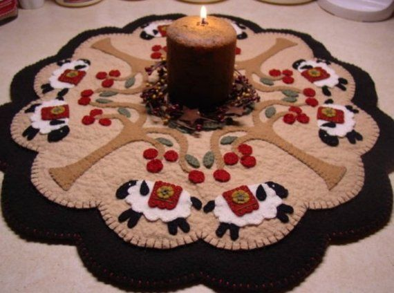 Arent these sheep adorable? This candle mat is quite simple to make and just so sweet! I used the same sheep from my other (quite popular) e-pattern. With the addition of some prim cherry trees. My instructions are clear and easy to follow. The finished rug measures roughly 14 inches