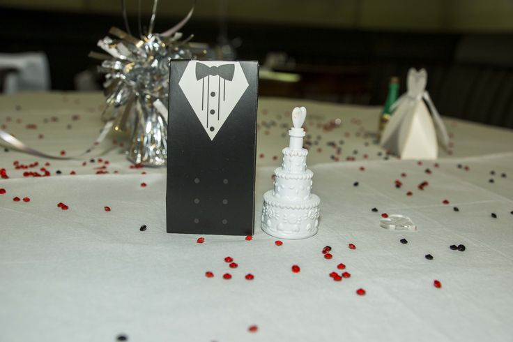 'Groom' and 'Bride' boxes filled with goodies, with bubbles.