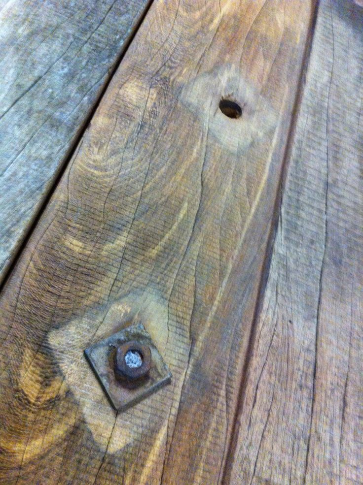 Rusitc details on a THORS Gaia table; the historic marks and fittings become a feature of the table