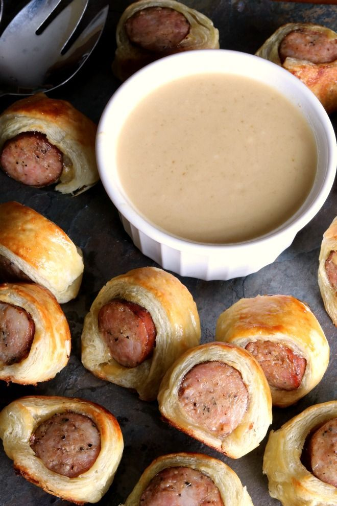 "Andouille Sausage Bites are an adult version of a ""Pigs in a Blanket"" type appetizer served with a Sweetened Dijonaise Dipping Sauce."