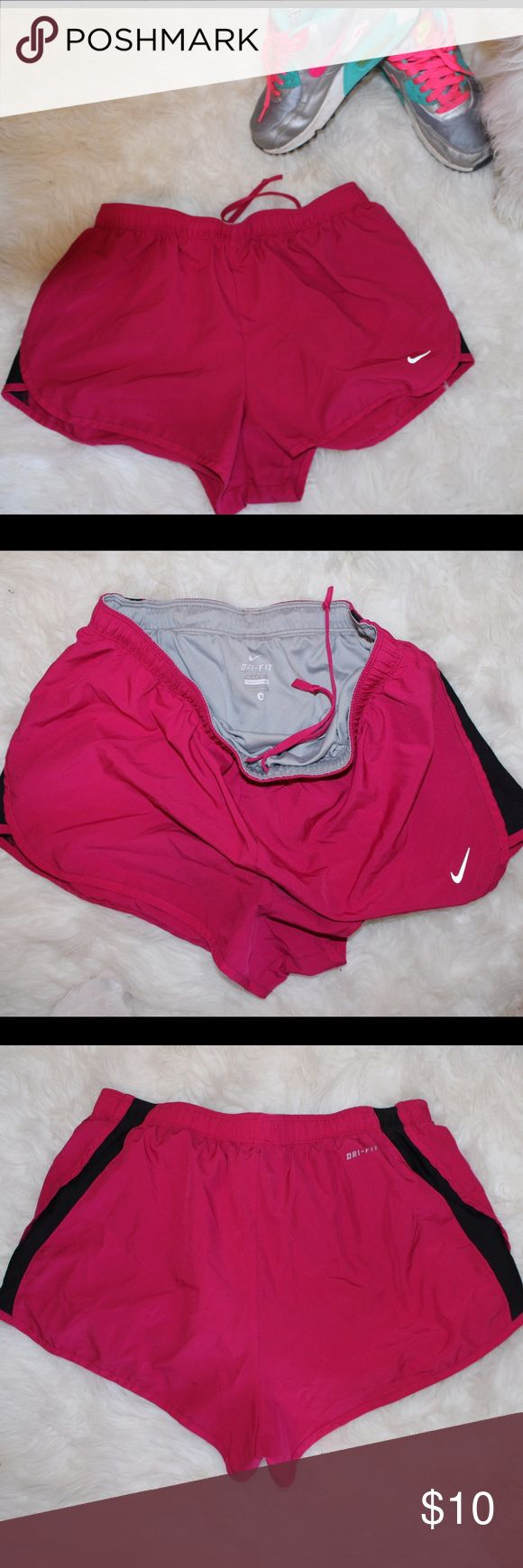 Nike Women's Pink Shorts Drunk-Fit pink and black nike shorts w underwear lining. small. doesn't look like tempo shorts on, not sure of the style. make an offer! Nike Shorts