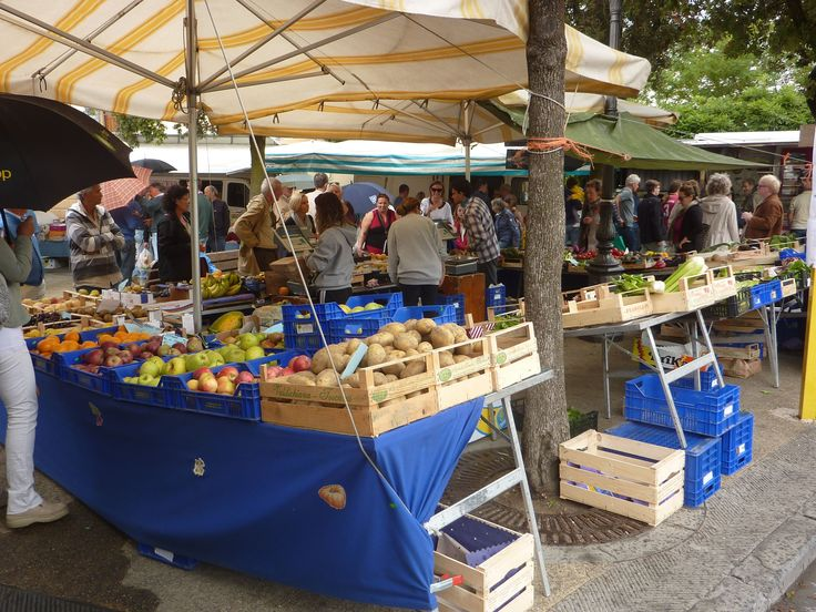 The weekly (Sunday morning) market held in the piazza at Panzano in Chianti, Tuscany.