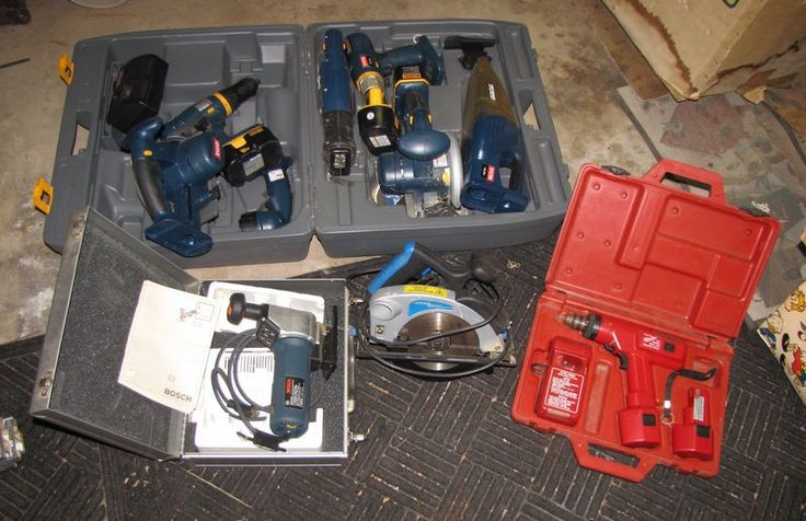 Powered hand tools including various Ryobi battery operated tools; Bosch jigsaw; Milwaukee cordless driver/drill; and Powerglide circular saw