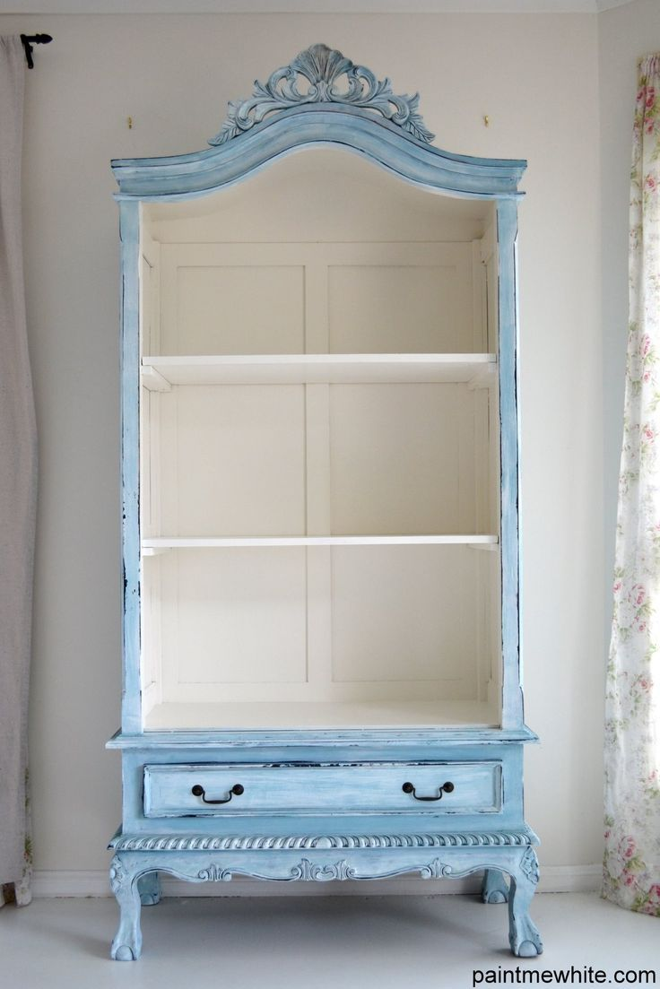 doors removed for shelving storage instead of armoire - white and light blue cabinet