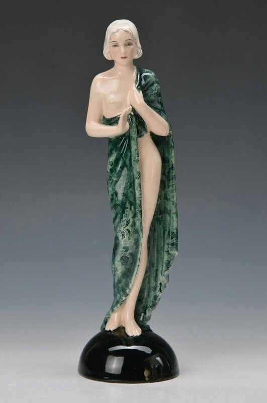 Art Deco figurine, Goldscheider, 1930s, 'Riviera' by J.Lorenzl, elegant standing lady with green laceshawl, signed Lorenzl and with adhesive label with Titles and Name, Model no. 6760, marked 125 10 (scribed mark) and green painter's mark, polychrome painting, H.approx. 34 cm