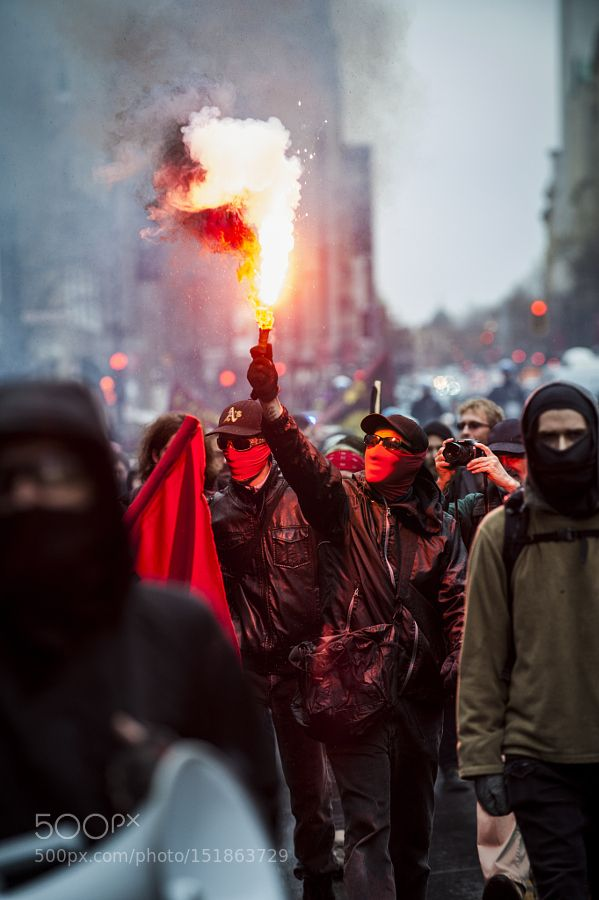 May 1 2016// A protester holds a flare up during t ... by andrejiphotography Journalism photography #InfluentialLime