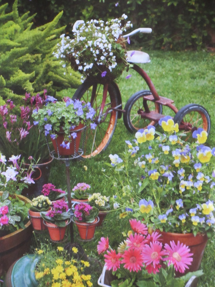 cute garden idea the old tricycle
