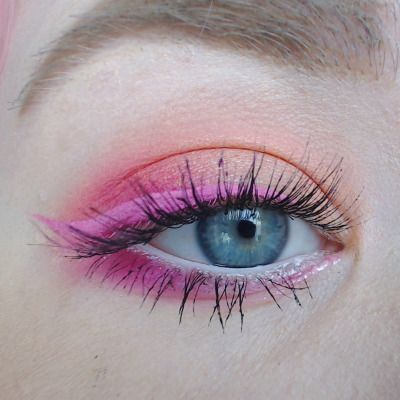 Bold pink eyeliner contrasts well with blue eyes for a striking look                                                                                                                                                                                 More