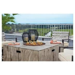 Kick back and relax under the stars. The Peachstone outdoor fire pit has the woodsy look you love with none of the worries about deteriorating in the outdoor air. Fire pit ignites with a simple press of a button and transforms into a coffee table when capped with the included burner cover. Signature Design by Ashley is a registered trademark of Ashley Furniture Industries, Inc.