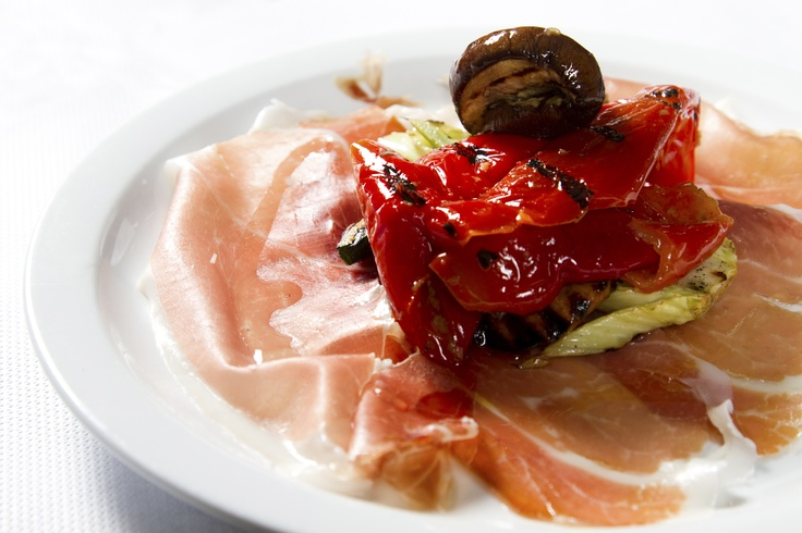 Iberican Serrano prosciutto with grilled red peppers, artichoke hearts and marinated mushrooms