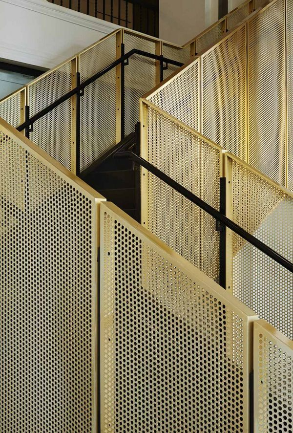 A stunning staircase in perforated metal by Studio Gang.