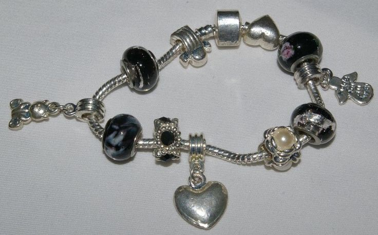 Bracelet, charms, glass beads, angels, heart.