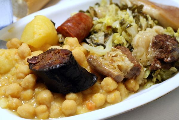 Try out these 7 popular foods in Madrid! Pictured here is cocido madrileno.