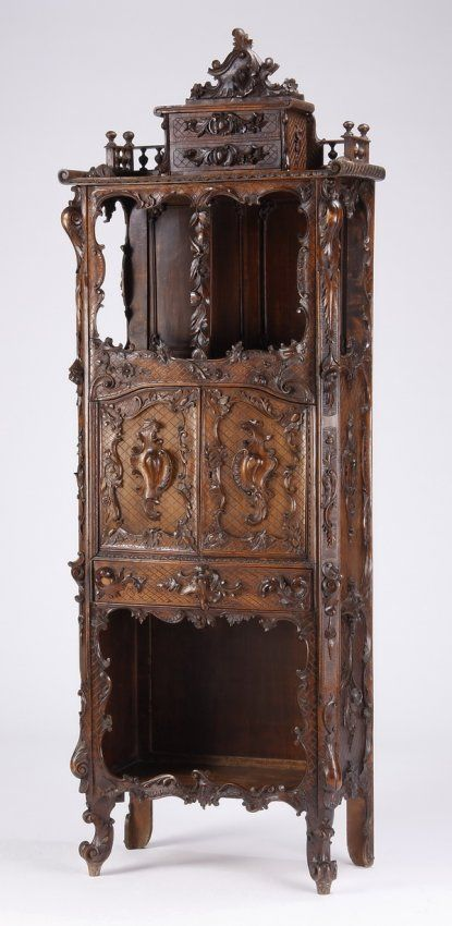 Intricately Relief Carved French Rococo Style Walnut Etagere With Double Door Central Storage, Open Upper And Lower Shelves, And Two Petite Storage Drawers At The Top