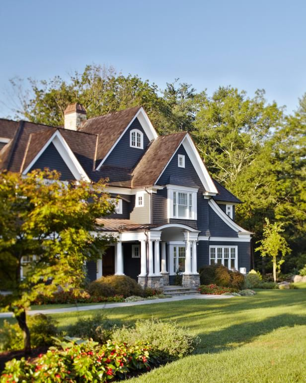 Hgtv Presents A Tudor Style Home Featuring Copper Metal Roofing Lepage Window In 2020 House Paint Exterior House Exterior Blue Exterior House Paint Color Combinations