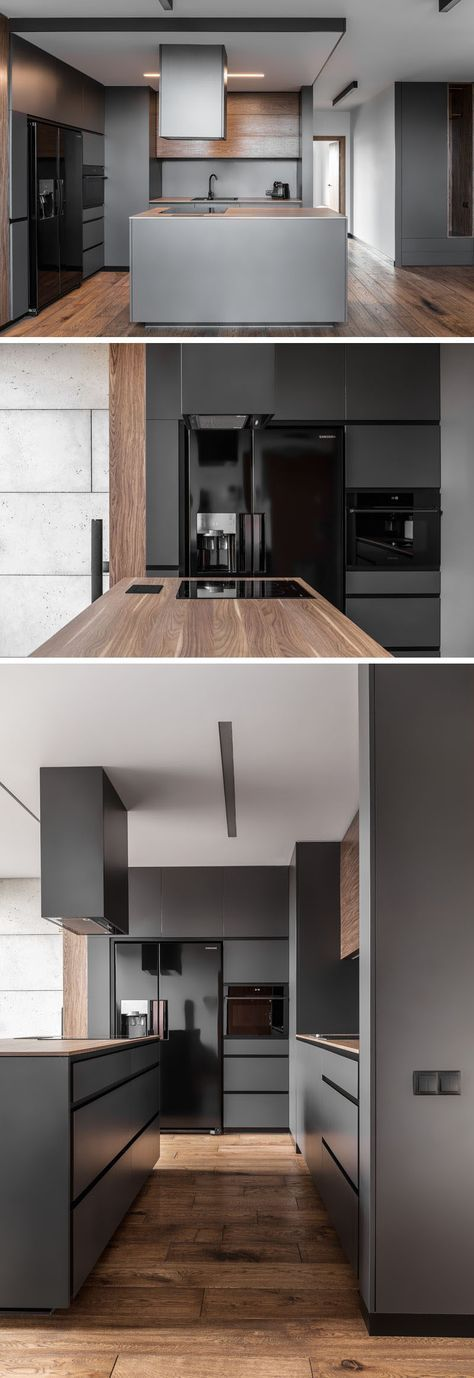 In this modern kitchen, dark grey walls and cabinets have been paired with glossy black appliances and wood elements for a contemporary and streamline appearance.