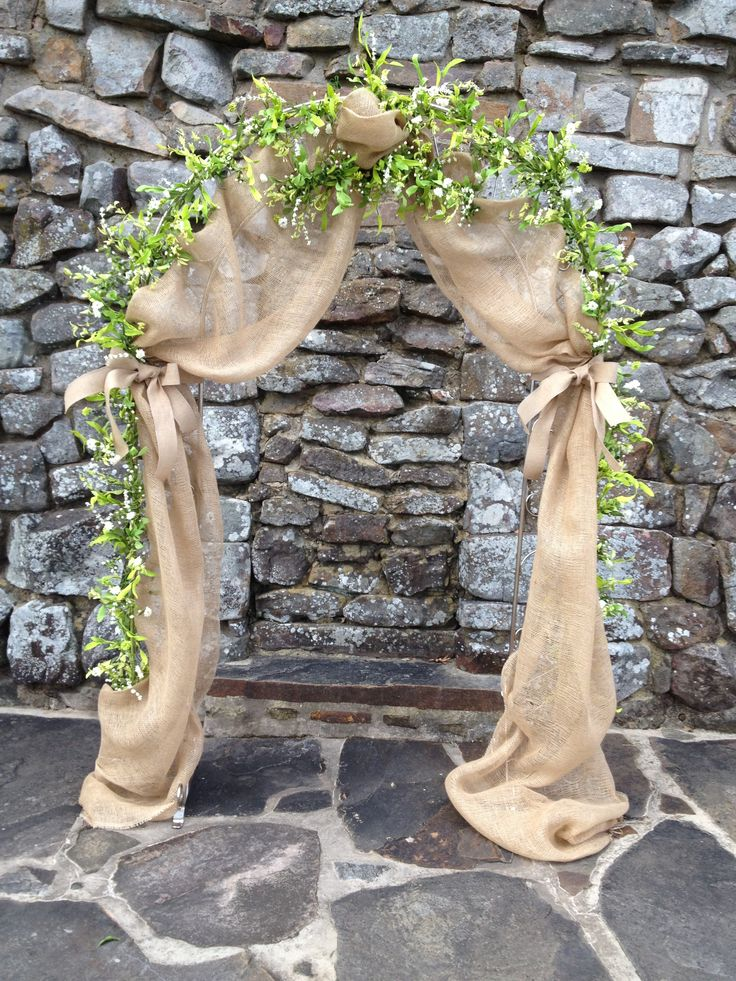 Best 25 burlap wedding arch ideas on pinterest burlap weddings burlap and garland wedding arch junglespirit Image collections