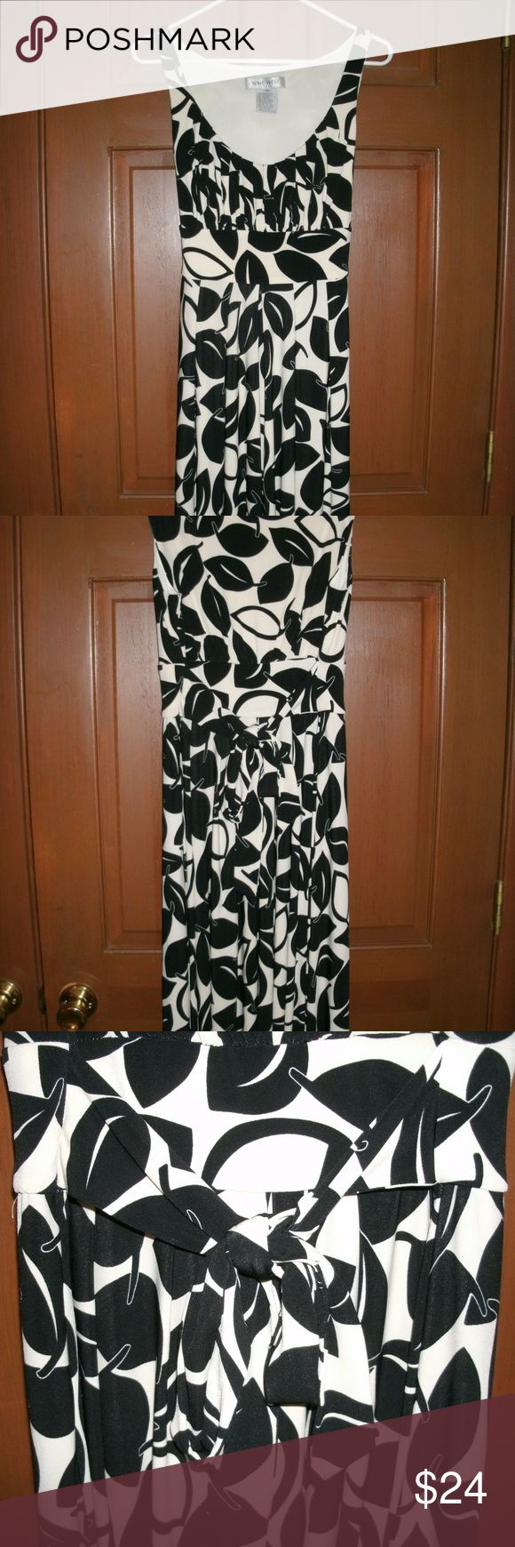 Nine West Black White Sleeveless Midi Dress Nine West Dress  ~white with black leafs ~skirt of dress is A-line ~side zipper ~back tie ~falls mid-calf  Bust: 32 inches     Shoulders: 13 inches     Waist: 32 inches     Hips: 52 inches     Length: 39 inches   95% Polyester; 5% Spandex  Good used condition. Some faint marks on the front of the dress - about 8 inches from hem. Nine West Dresses Midi