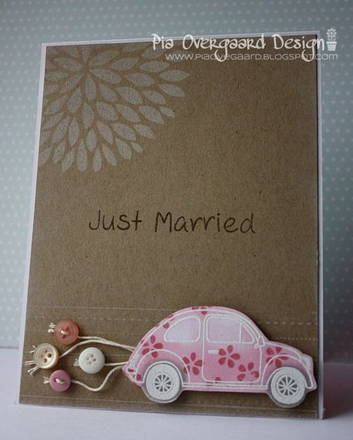 Simple and fun handmade wedding card. Kraft paper base and a fun flowered beetle bug car with buttons dragging behind instead of cans.