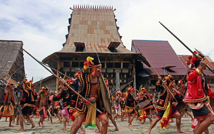 War dance in Bawömataluo village, south Nias. War dances used to be a way to train for war and to re-enact old battles. It was also done before actual battle in order to work up aggresion towards the enemy. Nias Island, North Sumatra, Indonesia. Photo courtsey of Agus Mendröfa.