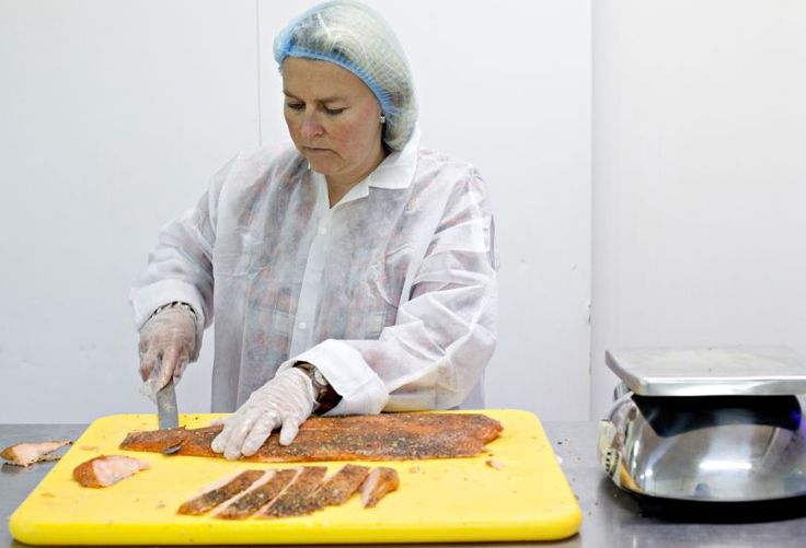 10th step of the production process: Slicing the smoked salmon sides and packaging it into the smaller and bigger packs the way we need them.