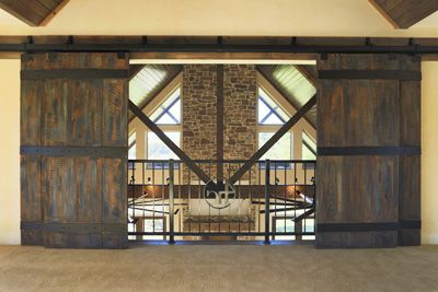 Great idea...hang barn doors so boys can close the loft when they are in the game room with friends and can open it to below the rest of the time!