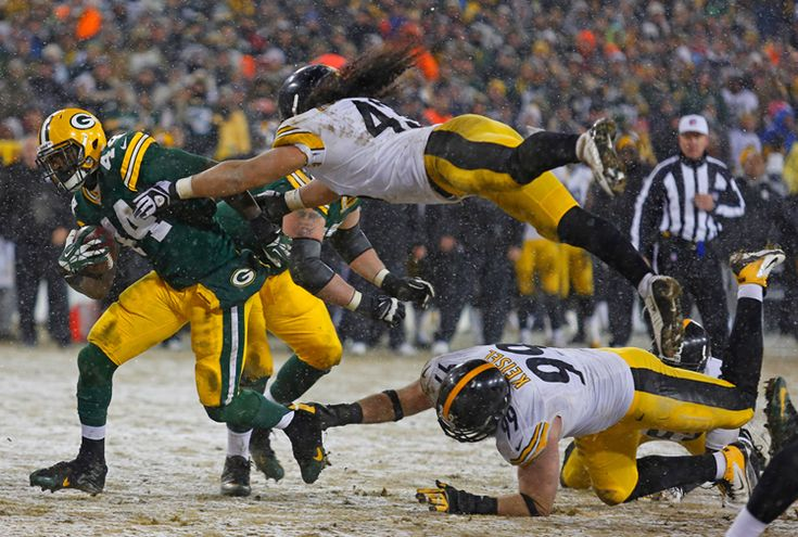 Brett Keisel and Troy Polamalu both make a diving tackle on James Starks