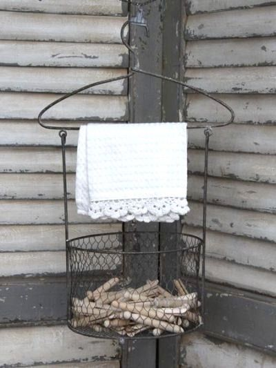 I love the whole idea of hanging clothes out to dry, beautiful wicker basket, and the old time clothespins.  I know, I'm silly.