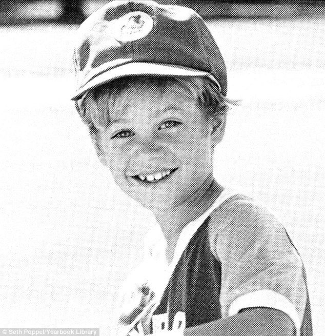 Paul as a young boy playing baseball