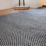 Hand Crafted Black And Beige New Zealand Wool Rug