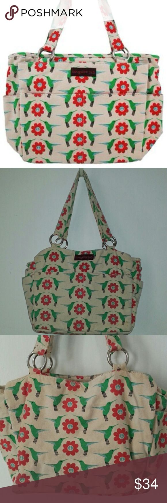 """Bungalow360 Hummingbirds&Peace Flowers Pocket Tote 4 outside panel pockets 2 side compartments with velcro closures Outer Material: canvas White polka dots on red lining. 11"""" x 10"""" x 4.5"""" 100% natural cotton canvas Bungalow 360 Bags Totes"""