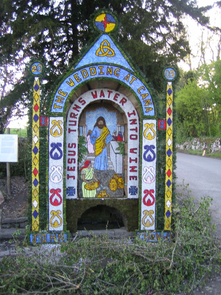 Well dressing in Tissington, Derbyshire. Ancient tradition. FYI these are made from flower petals.
