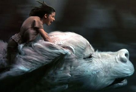 Never Ending Story  Falcor. I loved this movie so much! And my older sister hated me for it :( lol