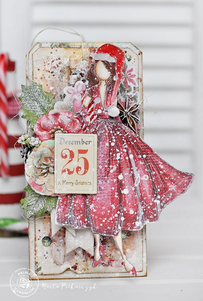 """""""I love the magic of Christmas time, and I love to create different decorations for each year. For this project, Julie Nutting's 'Rita' doll received a Christmas hat, and she is the focal decoration for my Christmas tag."""" ~ Marta Piekarczyk"""
