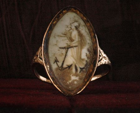 Gold mourning ring.....woman with an anchor.....probably depicting a relative or love lost at sea.
