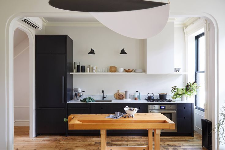 Small streamlined Brooklyn kitchen with black cabinets by ...