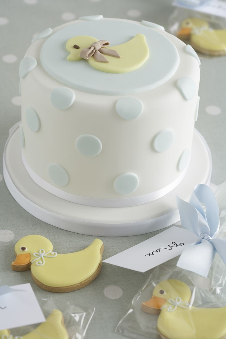 Simple White Cake with Baby Blue Dots and Yellow Duck Topper and Cookies