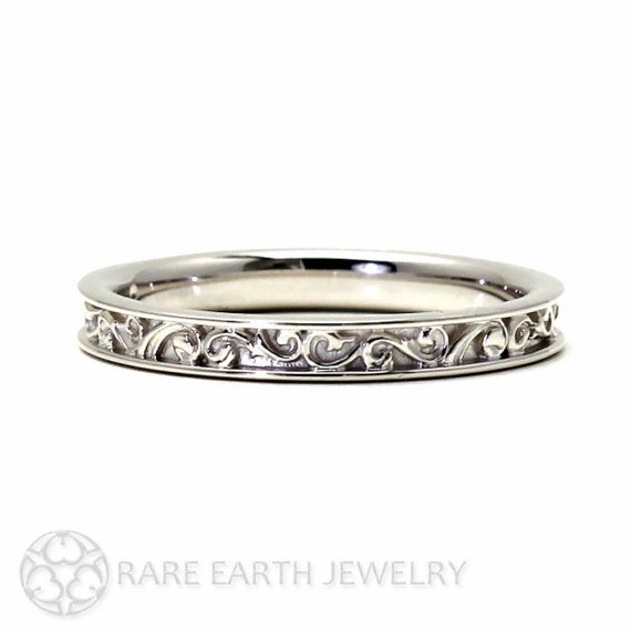 A lovely filigree scroll wedding band in your choice of 14K White, Yellow or Rose Gold or Palladium. This band pairs well with antique and vintage
