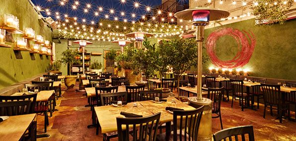 An enchanting courtyard where Eric Greenspan cooks intensely flavorful, shellfish-packed broths.