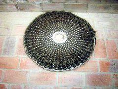 SCOURTIN en galette pour presse hydraulique. Le scourtin, réalisé en fibres végétales est une poche et un filtre qui permet, depuis l'Antiquité d'extraire l'huile d'olive.