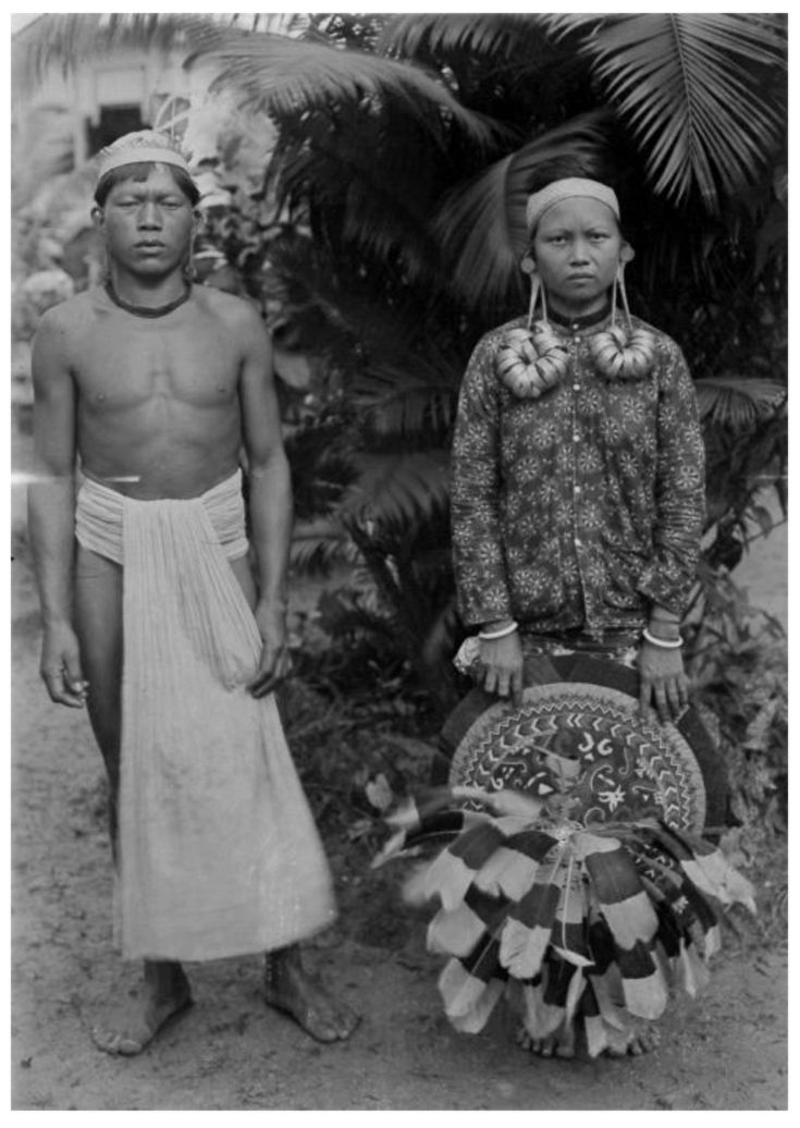 Indonesia ~ Kalimantan | Portrait of a Dayak man and a Apo Kayan woman | Date and photographer unknown