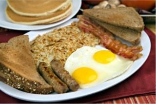 Breakfast Deluxe :Two pancakes, two eggs, two bacon strips & two sausages. Served with hash brown, toast & jelly from Pico Pica Rico Restaurant in Los Angeles #Food #Breakfast #Restaurant forked.com