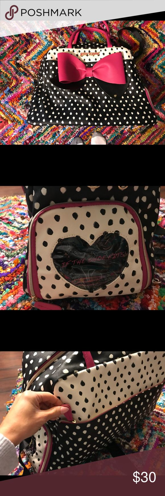 Betsey Johnson Polka Dot Weekender with Pink Bow 20x13x9 in size. I've barely used this, and the only imperfection is that the bow needs an easy fix. It needs to be sewn back on to the bag on one side (as pictured). I can do it for you, if you want me to, but I want to make sure the buyer is aware. Price reflects. This thing has pockets for days! One on each end, one on front and back, and on both sides inside as well. It can be used as a diaper bag. I used it as a weekend tote once, and…