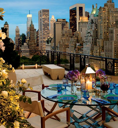 NYC living!  Mica Ertegun designed this penthouse for a client in a Robert A. M. Stern building. It runs a full city block in length. It has multiple terraces including this one devoted to outdoor dining.