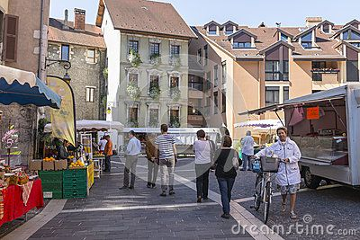 Market Square  in small  town Annecy,France. Old street and people on street market .  http://en.wikipedia.org/wiki/Annecy