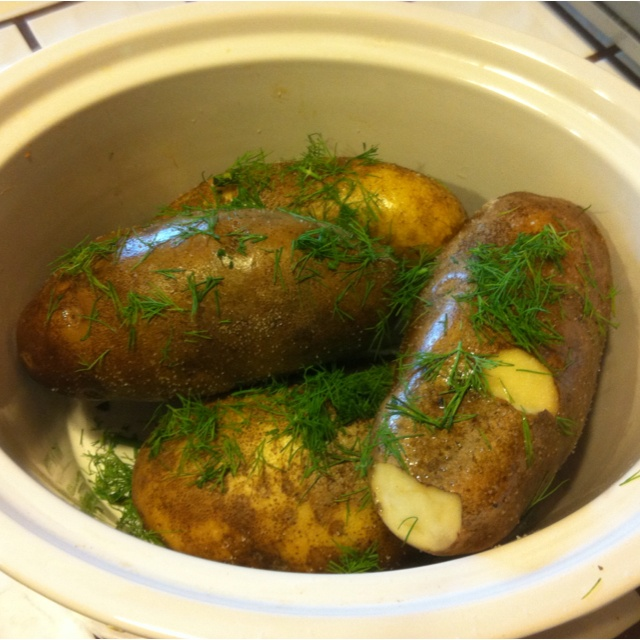 The easiest way EVER to make baked potatoes like you get at Outback:  clean your taters, rub them in olive oils, sprinkle w coarse salt and dill.  Pop in crockpot (no foil, no pricking holes, no water) on high for approx 6hrs (depends on size of bakers).  Voila!  Top w cheddar, spur cream and chives---yummy, complete w that mildly crispy, salty skin.
