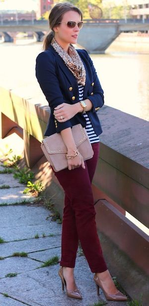 Striped top with a preppy double-breasted blazer and a pair of oxblood jeans. Perfect office look.